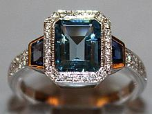 A SUPERB BLUE TOPAZ AND DIAMOND RING set in 18ct w