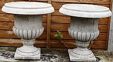 A PAIR OF RECONSTITUTED STONE CAMPAGNA URNS. 1ft 5