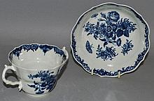 A WORCESTER BLUE AND WHITE TWO HANDLED CUP AND SAU