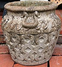 A RECONSTITUTED STONE CIRCULAR GARDEN URN of Celti