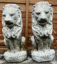 A PAIR OF RECONSTITUTED STONE FINIALS MODELLED AS