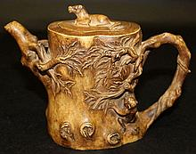 A CHINESE YIXING CERAMIC TEAPOT & COVER, modelled