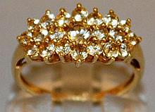 A GOOD CLUSTER DRESS RING set in 9ct gold.