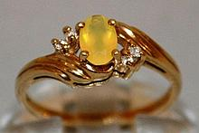 A SMALL DRESS RING set in 9ct gold.