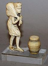 A CARVED IVORY FIGURE WITH A BARREL.