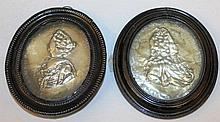 A PAIR OF OVAL SILVER PORTRAITS OF GEORGE III AND