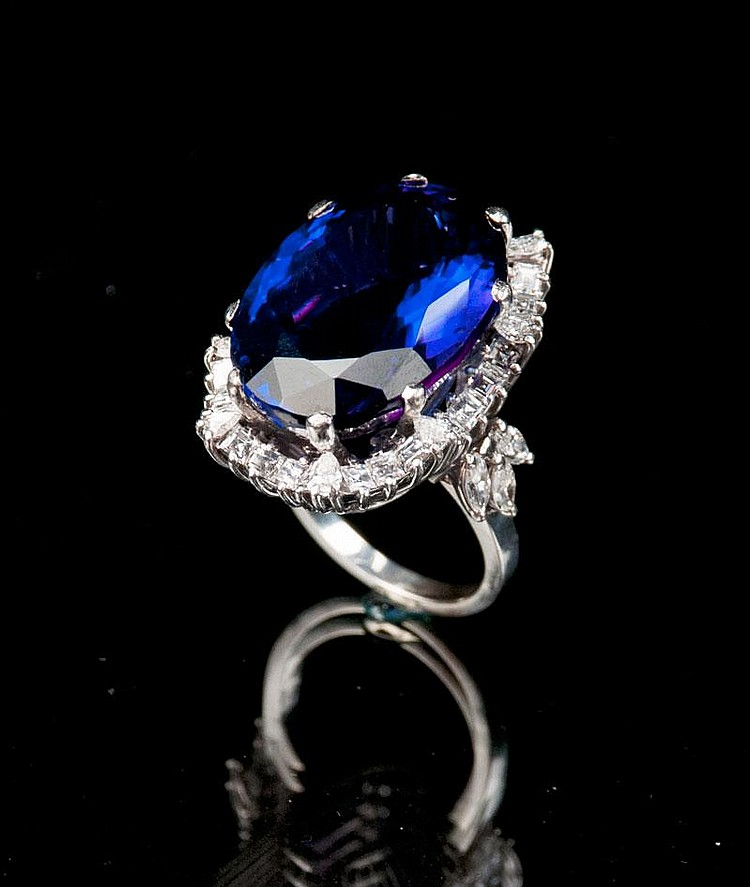 18 kt. white gold ring with one oval tanzanite, approx. 37.00 cts. and 44 round, pear shaped and marquise cut diamonds, approx. 4.00 cts.