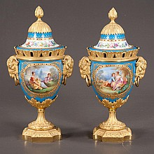 "Exceptional pair of bronze ormolu mounted Sevres porcelain urns with garden scene and figural decoration, c.1860, 12"" high"