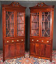 """Pair of inlaid Sheraton mahogany corner cupboards with broken arch pediments, mullion glass doors, shaped apron and splay feet, c.1850, 40"""" wide, 20"""" deep, 92"""" high"""