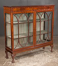 "Sheraton style mahogany bookcase cabinet with carved top, mullion glass doors and on short cabriole legs with ball and claw feet, c.1900, 48"" wide, 15"" deep, 48"" high"