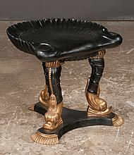 """Black and gilt shell carved grotto stool supported on three carved dolphin shaped legs on trifid base, 20"""" wide, 21"""" deep, 19"""" high"""