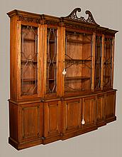 "Fine English Chippendale style mahogany breakfront bookcase with blind fret carved cornice, mullion glass doors in the top and fielded panel doors in the base, 101"" wide, 18"" deep, 84"" high"