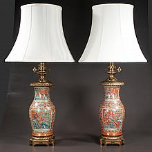 "Pair of bronze mounted Chinese porcelain lamps with floral, scenic, bird and peacock decoration, 38"" high"