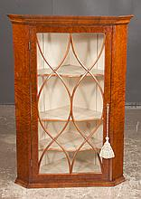 """Sheraton mahogany hanging corner cupboard with oval mullion glass doors, serpentine shaped shelves and moulded base, c.1860, 28"""" wide, 22"""" deep, 34"""" high"""