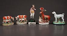 """Collection of Staffordshire pottery including a vase with fox-8"""" high, pair of cows with calves, spotted dog and figure of a Falconer, five pieces"""
