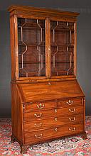 "Fine Chippendale mahogany bureau bookcase with blind fret carved cornice, mullion glass doors, good fitted interior and bracket feet, c.1800, 46"" wide, 21"" deep, 89"" high"