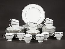 Partial set of Wedgwood china in the Amherst pattern, set includes, 12 dinner plates, 12 salad plates, 12 bread and butter plates and 12 cups and saucers