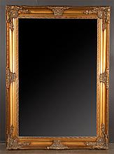 Gold gilt bevelled edge over the mantle mirror with decorative shell and scroll corners, overall size 72