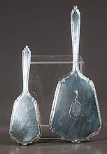 """Alvin sterling silver hand held dressing mirror, 14"""" diameter, and a brush with 10"""" handle, c.1920, two pieces"""