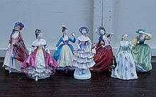 Group of 7 Royal Doulton figures of young women, Carolyn, Southern Belle, Leading Lady, Meg, Paisley Shawl, Buttercup and Autumn Breezes.