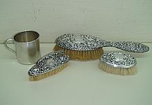 A Gorham sterling silver hand held brush, 9