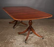 Two pedestal Sheraton style mahogany dining table with burl walnut banded top and three leaves, by Baker Furniture Co., c.1920, 68