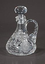 Cut glass wine decanter with shaped handle and etched flower design, c.1920, 9