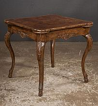 Queen Anne style walnut game table with rounded corners, shaped apron, cabriole legs with carved knees and hoof feet,