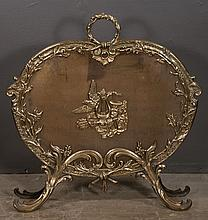 French style oval brass fire screen with bird, floral and musical instrument decoration, 28