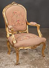 Louis XV style gold gilt fauteuil with leaf and floral carved back, carved apron, carved cabriole legs and covered in floral tapestry, 26