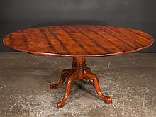 Queen Anne style cherry dining table, base with turned center column and four cabriole legs with pad feet, 66