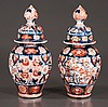 Pair of Imari porcelain dome top ginger jars with cobalt blue and bittersweet, bird and floral decoration, c.1860, 10