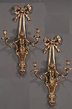 Pair of brass wall sconce with ribbon design at the top and putti holding double arm candleholders, 12