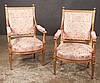 Pair of Louis XVI style fauteuils, the giltwood frames with fluted finials on carved and fluted legs, 24