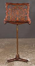 Victorian style sheet music stand, the walnut square panel with carved and reticulated leaf decoration, 22