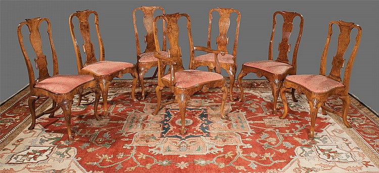 Set of twelve Queen Anne style walnut dining chairs with scroll carved backs, shaped seats with shell carved apron, cabriole legs and pad feet, c.1900; armchairs 25