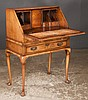 Queen Anne walnut slant top desk with good fitted interior, cabriole legs and pad feet, c.1890-1900, 28