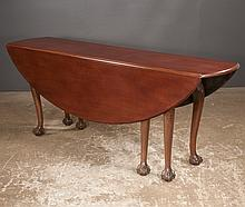 Chippendale style mahogany drop leaf hunt table with oval shaped drop leaves, cabriole legs, carved knees and ball and claw feet, 78