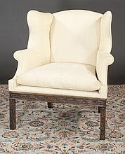 Chinese Chippendale style mahogany wing chair with blind fret carved apron and legs, 36