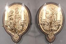 Pair of oval Louis XV bronze two branch wall sconce with figural decoration in relief, c.1890, 10