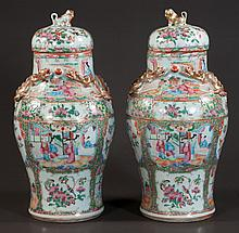 Pair of Chinese rose medallion porcelain urns with dome lids, panel scenery with figural and floral decoration, c.1860, 15