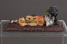 Cold painted bronze depicting a reclining woman on carpet, 7