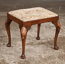 Queen Anne walnut foot stool with slip cushion, cabriole legs with gold gilt shell carved knees and pad feet, c.1900, 20
