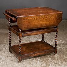 Jacobean style oak tea trolley with turn top on barley twist legs with lower shelf, c.1900, 32