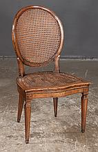 Louis XVI style walnut side chair with oval cane panel back and cane panel seat on tapered legs, c.1900, 21