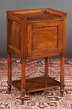 French walnut bedside cupboard with gallery top above a panel door on turned legs with lower platform, c.1860, 17