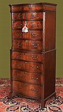 Chippendale style mahogany serpentine front chest on chest with tear drop crown moulding, carved chamfered corners on bracket feet, c.1860, 28
