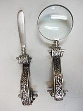 Desk set with a letter opener and magnifying glass, both with scrolling silver foliate decorated handles, 11