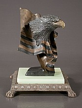 Bronze sculpture of an American Eagle head mounted on a bronze flag on a companion onyx and metal base, signed
