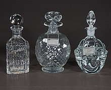 Group of three cut crystal decanters with sterling silver labels, signed Brieley